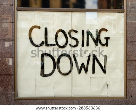 Closing down sign in a city centre shop. - stock photo