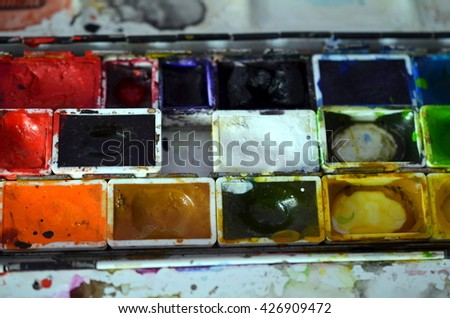 closup of a messy paintbox after using - stock photo