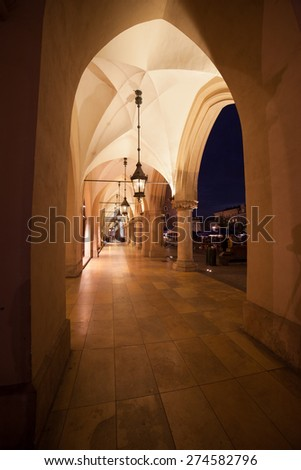 Cloth Hall (Polish: Sukiennice) colonnade at night in Krakow, Poland.