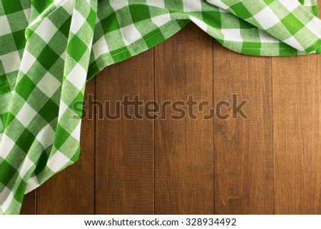 cloth napkin on wooden background - stock photo