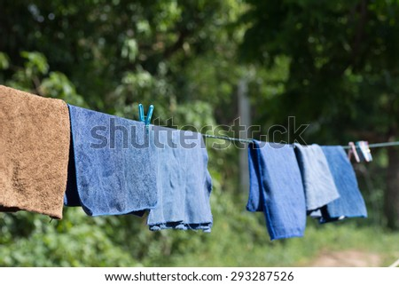 Clothes drying on a rope for sun.
