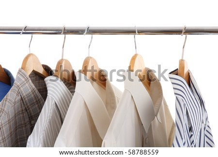clothes hanger with man's shirts - stock photo