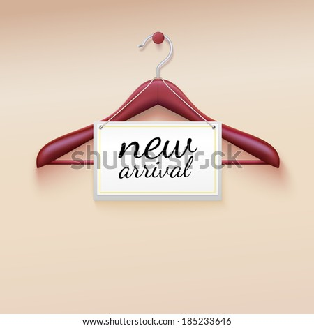 Clothes hanger with new arrival tag - stock photo
