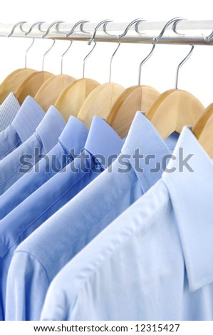 clothes hanger with shirts - stock photo