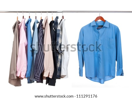clothes hanger with shirts on white - stock photo