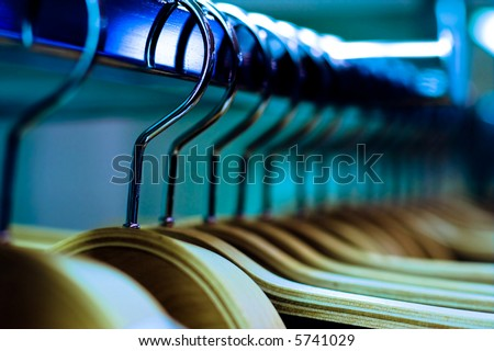 Clothes hangers in fashion store. Clothes business concept - stock photo