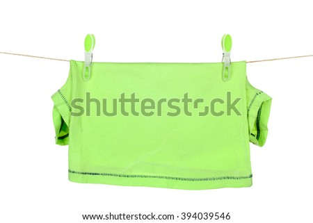 clothes hanging on rope attached with clothespins isolated on white background