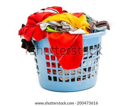 Clothes in a laundry basket on white background - stock photo