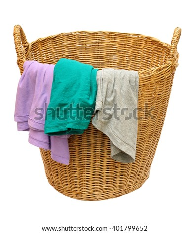 clothes in a laundry wooden basket on white background - stock photo