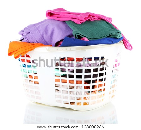 Clothes in plastic basket isolated on white - stock photo