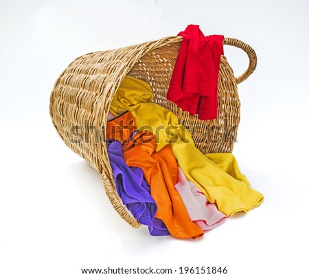 Clothes in wooden laundry basket  - stock photo