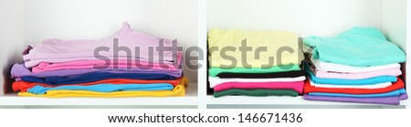 Clothes neatly folded on shelves - stock photo