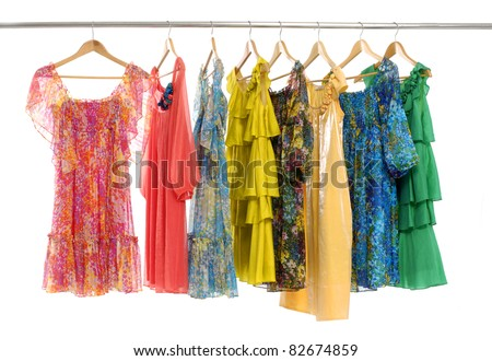 clothes of different colors on wooden hangers. - stock photo