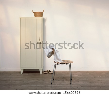 clothes on a chair - stock photo