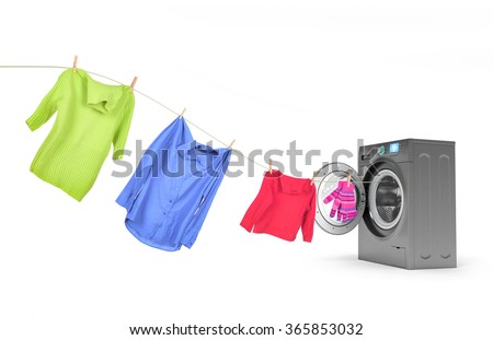 clothes on a rope with a washing machine - stock photo