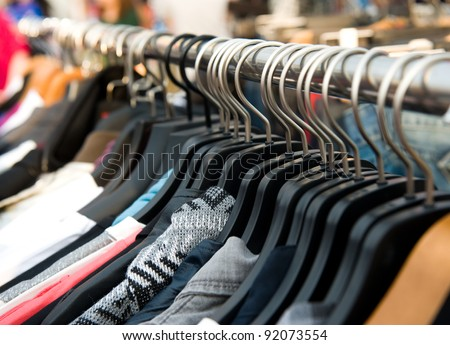 clothes on racks at the show. - stock photo