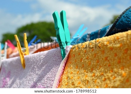 Clothes peg locked on drying towels - stock photo