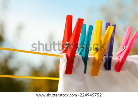 Clothes pegs on the washing line - stock photo