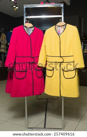 clothes rack with ladies coats for sale - stock photo