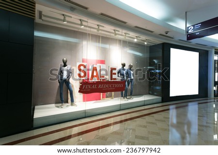 clothes storefront window with sale poster - stock photo