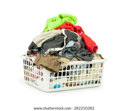 Clothes with basket isolated on white background - stock photo