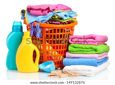 Clothes with detergent and washing powder in orange plastic basket isolated on white - stock photo