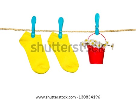clothesline with socks and flowers - stock photo