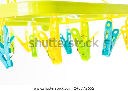clothespin on clothesline isolate on over white background - stock photo