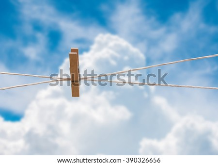 clothespin on rope in the sky - stock photo