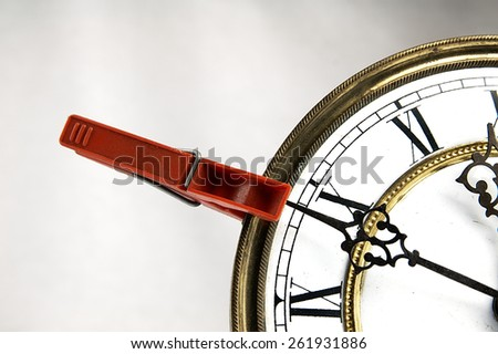Clothespin stop the clock. - stock photo