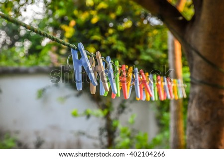 Clothespins and Clothes line on blur background - stock photo