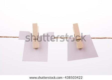 Clothespins holding clothes - stock photo