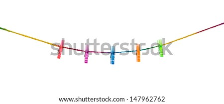Clothespins on raimbow rope with modern wall background .  - stock photo