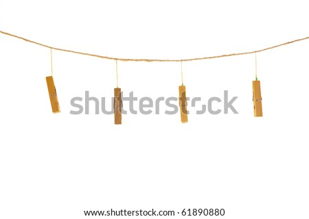 clothespins on rope isolated on white - stock photo