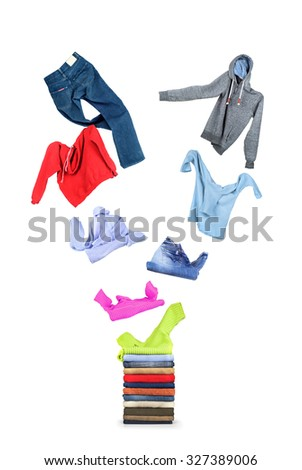 Clothing flies on a pile isolated on white  - stock photo
