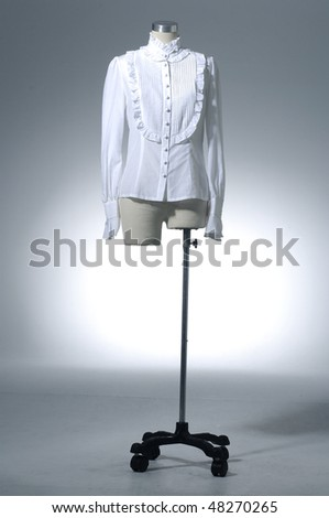 clothing hanging as display on light background