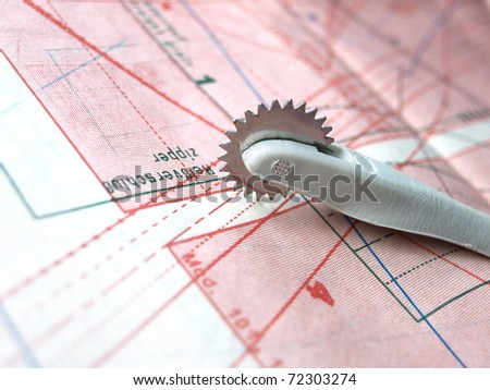 clothing patterns... and pastry cutting wheel. - stock photo