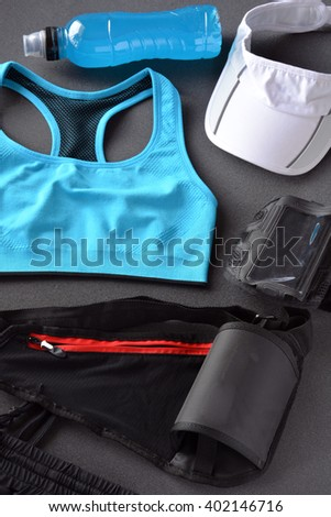 clothing women's fitness with drink energy and mobile phone