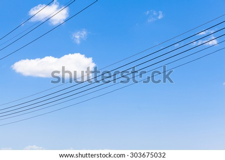 cloud and electricity cable with clear blue sky