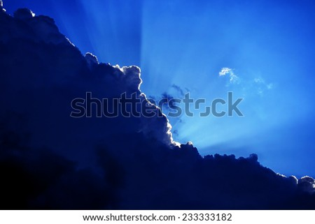 Cloud and sunlight contrasts sunbeam and dark clouds - stock photo
