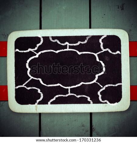Cloud as a symbol drawn on the blackboard - stock photo
