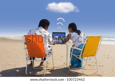 Cloud computing: Casual Workers having a business meeting at Beach - stock photo