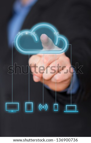 Cloud computing concept businessman touching the icon - stock photo