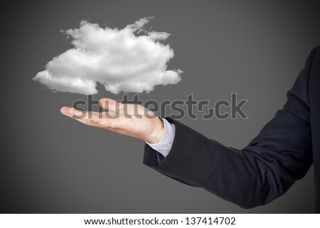 Cloud computing concept, businessman with cloud over hand - stock photo