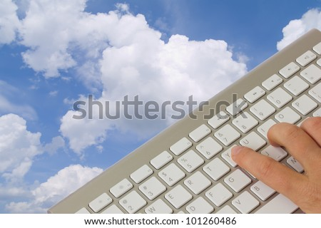 cloud computing  concept - keyboard over cloudscape - stock photo