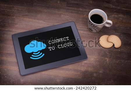 Cloud-computing connection on a digital tablet pc, vintage setting - stock photo
