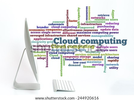 Cloud computing word collage spread out from computer screen. - stock photo