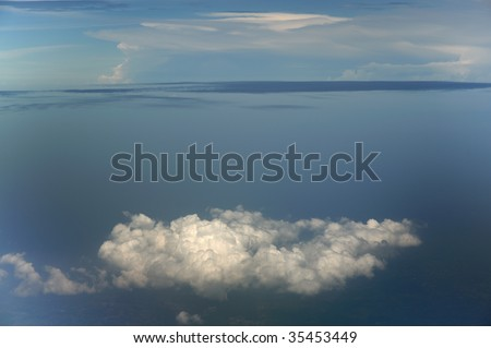 Cloud formation on top of island view - stock photo