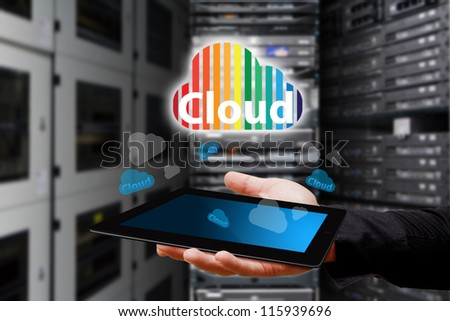Cloud icon from touch pad in data center room - stock photo
