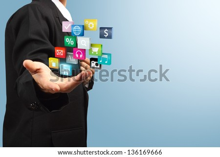 Cloud of colorful application icons in the hands of businessmen, Business software and social media networking service concept, Save paths for design work - stock photo